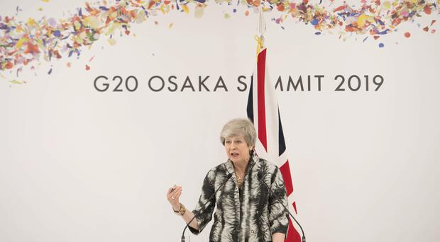 Theresa May holds a news conference at the end of the G20 summit in Osaka (Stefan Rousseau/PA)