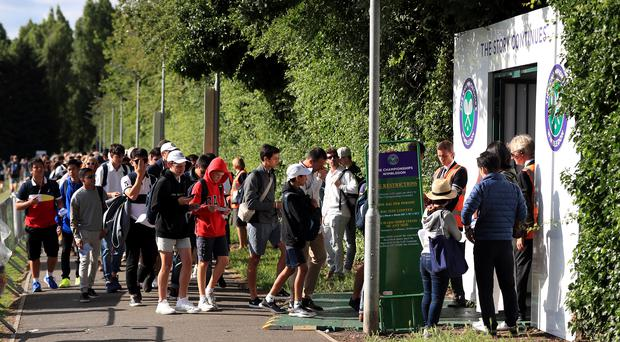 Campers in the queue on day one of the Wimbledon Championships (Mike Egerton/PA)