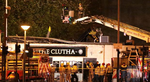 Emergency services at the scene of the police helicopter crash at the Clutha Bar in Glasgow (Andrew Milligan/PA)