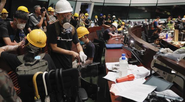 Protesters inside the meeting hall of the legislative council in Hong Kong (Kin Cheung/AP/PA)