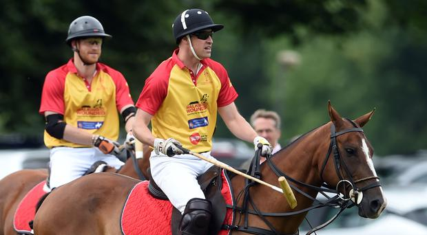 Harry and William taking part in the Jerudong Trophy charity polo match at Cirencester Park Polo Club (Joe Giddens/PA)