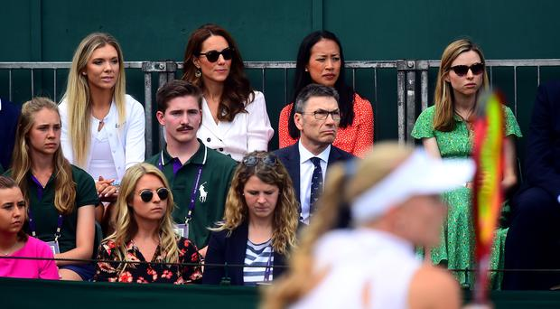 The Duchess of Cambridge with Katie Boulter (left) and Anne Keothavong (right) as they watch Harriet Dart in action (Victoria Jones/PA)
