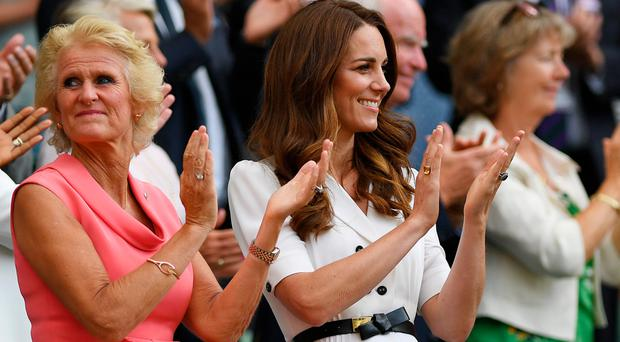 Catherine, Duchess of Cambridge, alongside Gill Brook, shows her support during day two of The Championships, Wimbledon