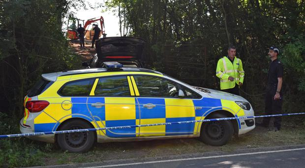 Police officers search an area near Pershore in Worcestershire, where they have begun further investigations into Suzy Lamplugh's murder (Matt Cooper/PA)