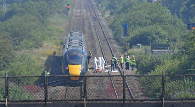 The scene on a section of track near Port Talbot after two railway workers died after being struck by a train (Jacob King/PA)