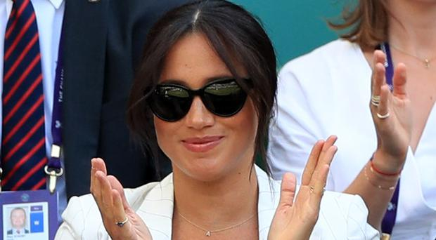 The Duchess of Sussex watches Serena Williams on Court One on day four of the Wimbledon Championships (Mike Egerton/PA)