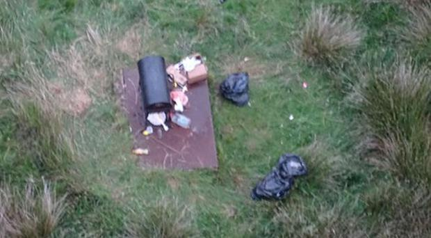 A barbecue being used on Saddleworth Moor (Greater Manchester Fire and Rescue/PA)