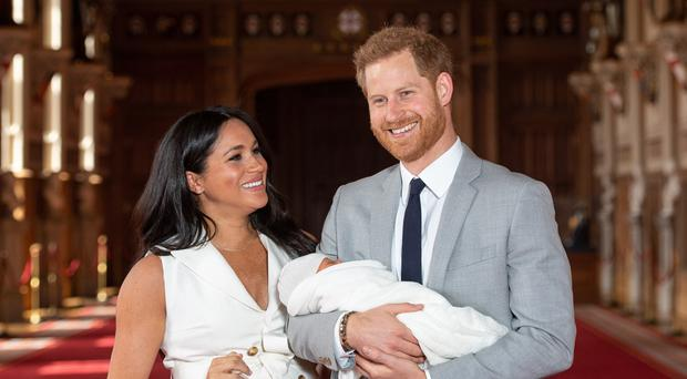 The Duke and Duchess of Sussex with baby Archie (Dominic Lipinski/PA)