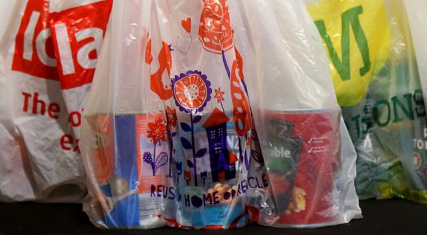 English shoppers pay a 5p charge for plastic carrier bags (Chris Radburn/PA)