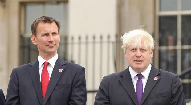 Jeremy Hunt, left, and Boris Johnson are going head to head in the Conservative leadership race (PA)