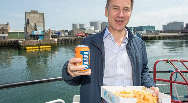 Conservative party leadership candidate Jeremy Hunt met with fishermean in Scotland's north-east (Michal Wachucik/PA)