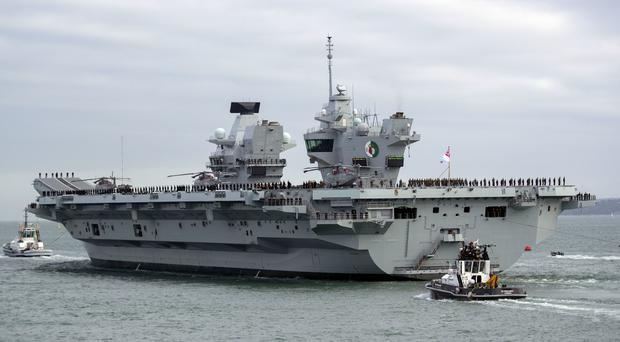 HMS Queen Elizabeth has returned to Portsmouth early as a precautionary measure (Steve Parsons/PA)