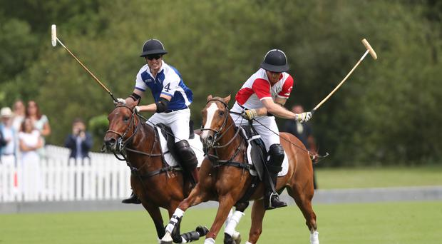 The Duke of Cambridge and Duke of Sussex play polo (Andrew Matthews/PA)