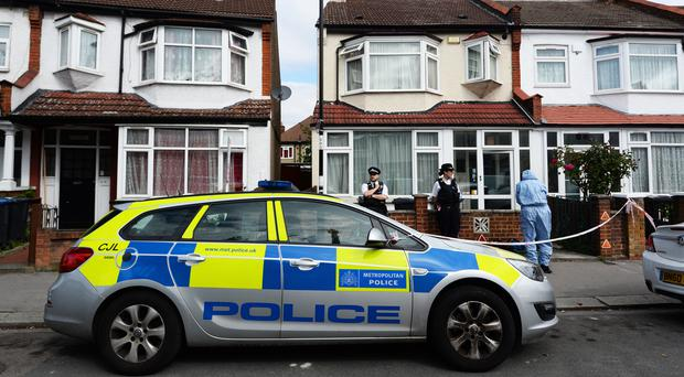Police officers at the scene in Raymead Avenue, Thornton Heath, Croydon (Kirsty O'Connor/PA)