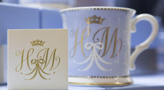 A tea cup bearing the initials H and M which formed part of the official range of china celebrating the Duke and Duchess of Sussex's wedding (Rick Findler/PA)
