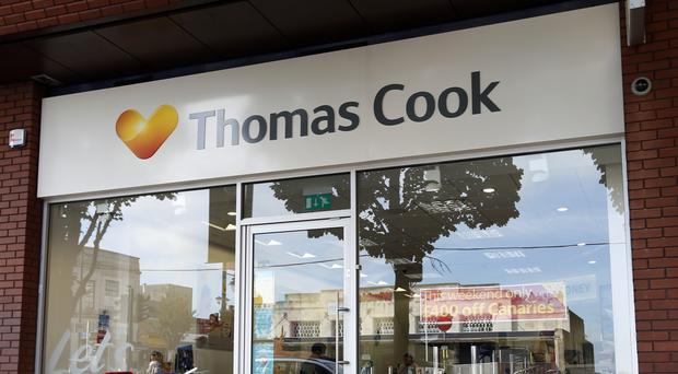 Thomas Cook has confirmed it is in advanced talks with Chinese firm Fosun over a potential sale of its tour operator business (Jonathan Brady/PA)