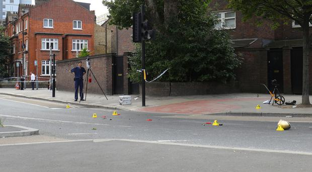 The scene in Battersea where a woman has died after being struck by a lorry while riding a scooter (Aaron Chown/PA)