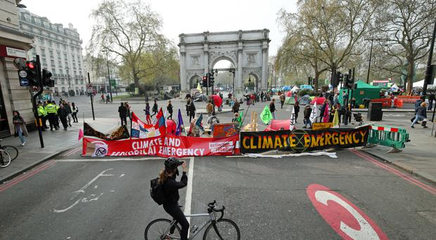 Demonstrators during an Extinction Rebellion protest at Marble Arch (PA)
