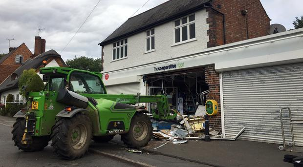 The scene at a Co-op in Scraptoft, Leicestershire, after a forklift truck was used to attempt to steal the cash machine (Karen Giddens/PA)
