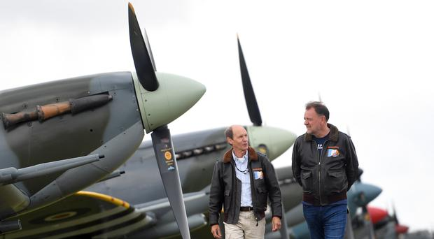 Founder of the Fighter Collection Nick Grey (right) and Fighter Collection chief pilot Pete Kynsey walk along the flight line before the Flying Legends Air Show at IWM Duxford (Joe Giddens/PA)