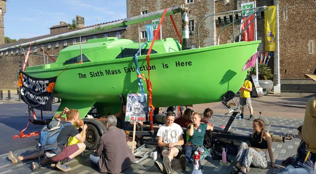 A large green boat was parked outside Cardiff Castle as part of the Extinction Rebellion protest (Steffan Webb)