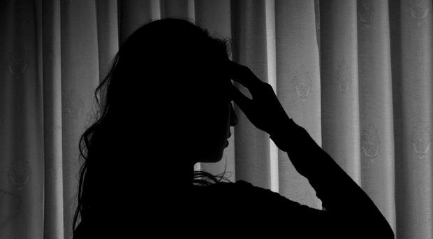 A woman showing signs of depression (PA)