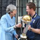 Prime Minister Theresa May with England cricket captain Eoin Morgan and members of the team with the trophy (Yui Mok/PA)