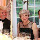 US President Donald Trump, Prime Minister Theresa May and Foreign Secretary Jeremy Hunt at the Return Dinner at Winfield House, the residence of the Ambassador of the United States of America (Chris Jackson/PA)