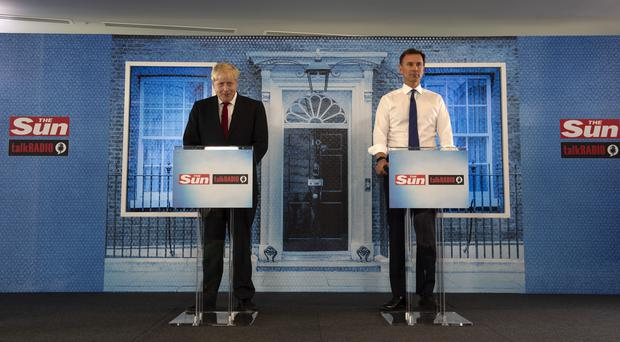 Both Tory leadership candidates ruled out backing the US in a war with Iran (Louis Wood/The Sun/PA)
