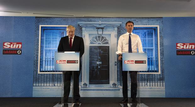 Boris Johnson and Jeremy Hunt during a head-to-head debate (Louis Wood/The Sun)