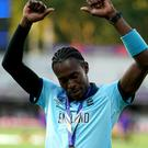 England's Jofra Archer celebrates winning the ICC World Cup Final (John Walton/PA)