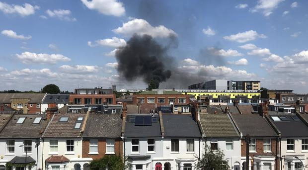 The blaze took hold at a block of flats in Acton, west London (Nick Morgan/PA)