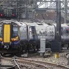 A woman was allegedly sexually assaulted on a train between Glasgow Central and Lanark (Danny Lawson/PA)