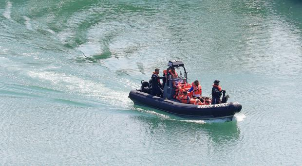 A Border Force boat carrying a family of suspected migrants arrives in Dover, Kent (Gareth Fuller/PA)