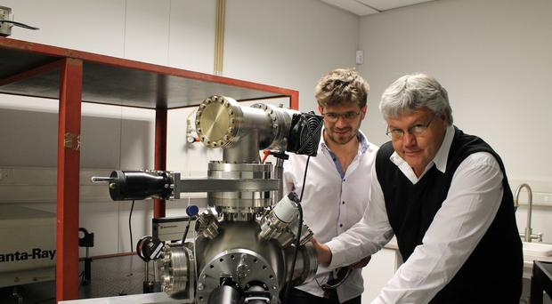 Researchers Lucas Erasmus and Prof Hendrik Swart with the equipment used for the ground-breaking research (UFS/PA)