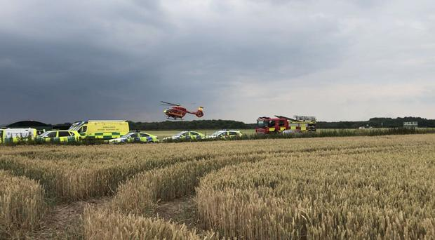 Emergency services at the scene of the plane crash near Penkridge, Staffordshire (West Midlands Ambulance Service/PA)