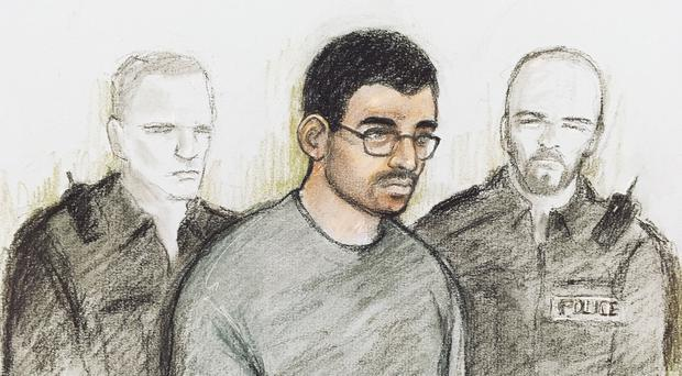 Court artist sketch by Elizabeth Cook of Hashem Abedi in the dock at Westminster Magistrates' Court in London, where he is appearing following his extradition from Libya.