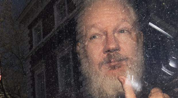 Julian Assange was jailed for 50 weeks for breaching his bail conditions, just short of the one-year maximum for the offence (Victoria Jones/PA)