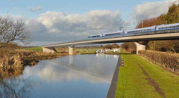 An artist's impression of an HS2 train on the Birmingham and Fazeley viaduct (HS2/PA)