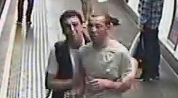British Transport Police handout CCTV image of two men they will like to speak to following an incident where gas was released on board a train carriage at Oxford Circus station in London (BTP/PA).