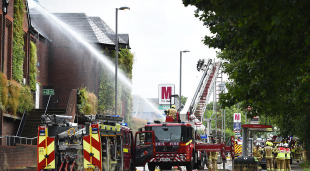 Firefighters at the scene (Kirsty O'Connor/PA)