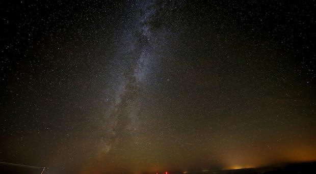 The Milky Way cannibalised a galaxy one quarter of its mass 10 billion years ago, research suggests (Owen Humphreys/PA)