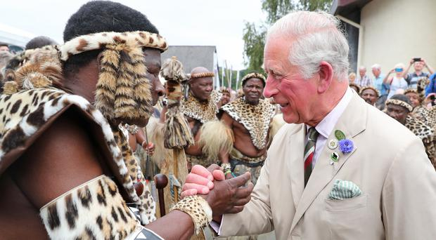 The Prince of Wales meets members of the Zulu 'impi' regiment during the 100th Royal Welsh Show (PA)