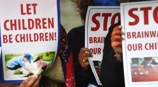 Protesters demonstrate outside Anderton Park Primary School in Birmingham (Jacob King/PA)
