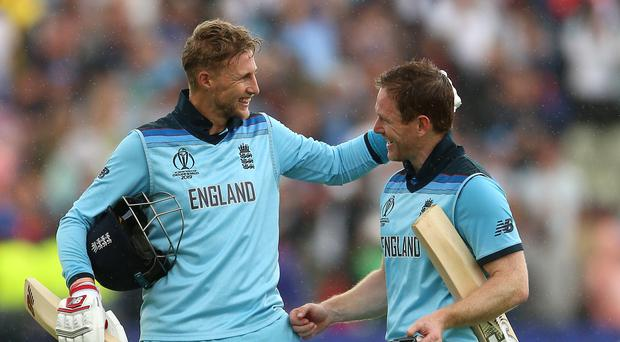 Eoin Morgan (right) with Joe Root during the Cricket World Cup (PA)