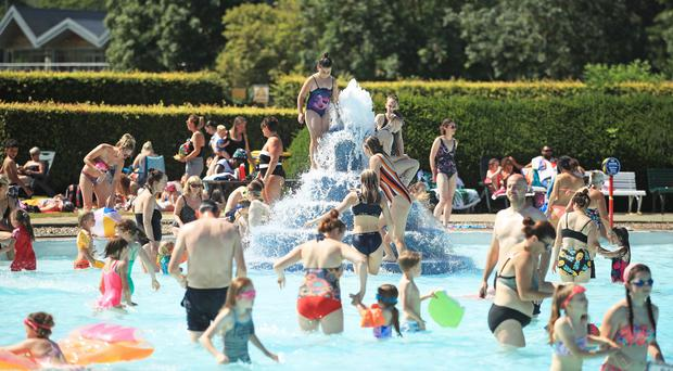 People play in the water at Ilkley outdoor pool and lido in West Yorkshire (Danny Lawson/PA)