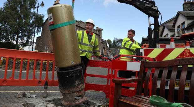 Workmen have reinstated the postbox in Dunblane after it was hit by a car (Andrew Milligan/PA)