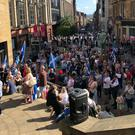 Buchanan Street in Glasgow where hundreds of people gathered to demonstrate against the appointment of Boris Johnson (Douglas Barrie/PA)