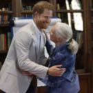 The Duke of Sussex hugs Dr Jane Goodall (Kirsty Wigglesworth/PA)