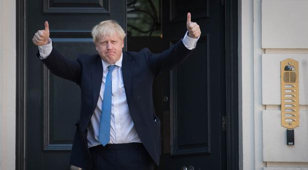 Newly elected leader of the Conservative party Boris Johnson arrives at Conservative party HQ in Westminster, London, after it was announced that he had won the leadership ballot and will become the next Prime Minister (PA)